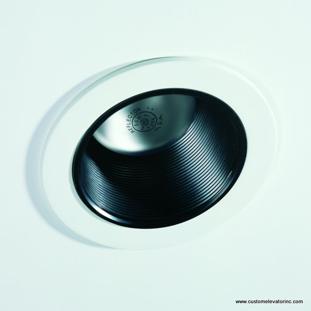 4 in. diameter incandescent down light with white trim ring and black baffle